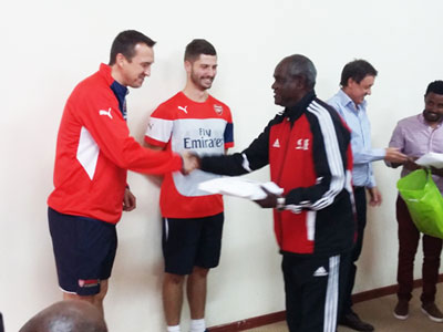 Sewnet Bishaw Giving the gift to Arsenal Coaches